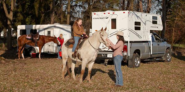 truck-camper-with-horses-rvia