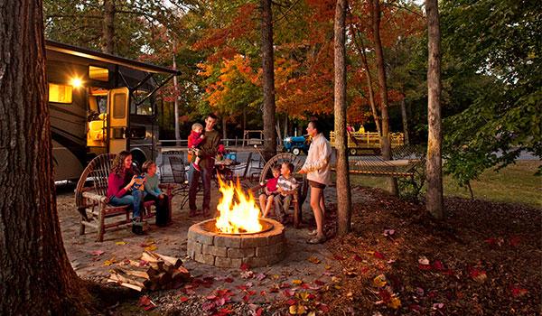Family-Camping-by-Campfire-in-fall_KOA